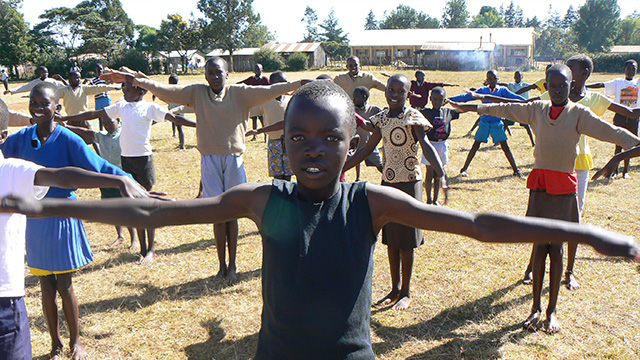Kenyan children exercising