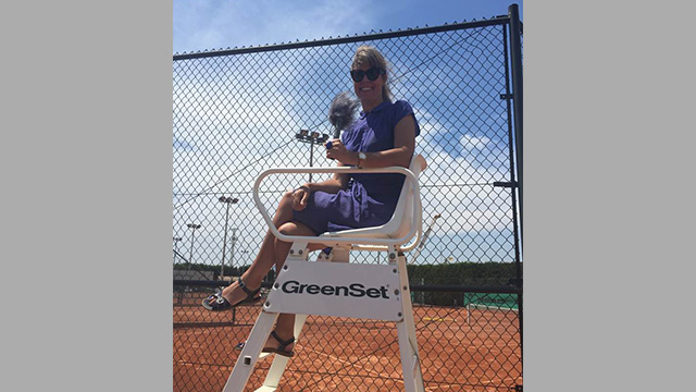 Claudia in a tennis umpire's seat