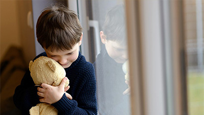A child and teddy bear